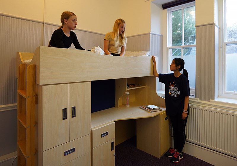 School House boarding room with students chatting