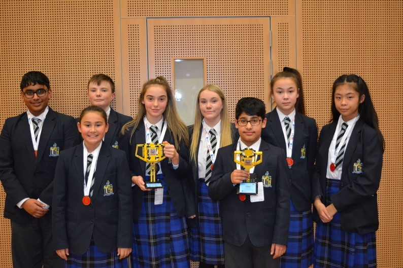 Children from St Bees School holding their LEGO League trophies